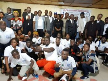 Minister Bangura in a group photo with participants at the Program