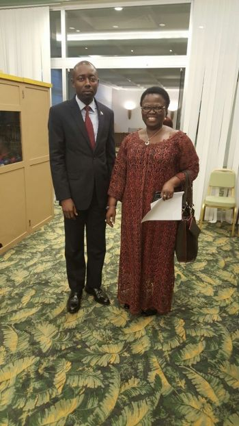 Minister Marvie post with the Togolese Trade Minister